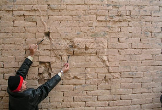 Babylon: Myth and Reality — Damage to dragon reliefs at Babylon, 2004. © John Curtis - Trustees of the British Museum
