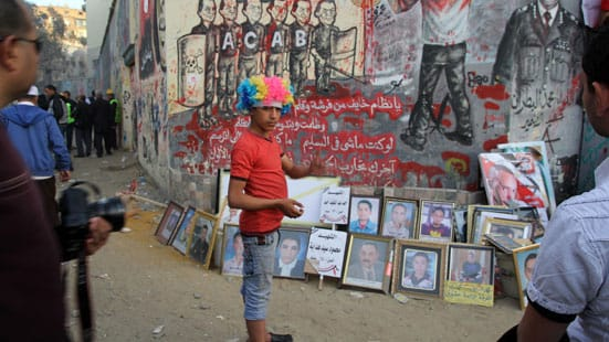 Ronnie Close, Street protest against President Morsi, Tahrir Sq Nov 2012. (wigs and masks are popular).
