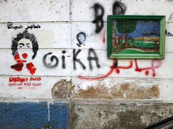 Ronnie Close, Stencil for April 6th murdered member, Giko, 17 years old, Tahrir Sq Nov 2012. (don't know what the painting is doing there)